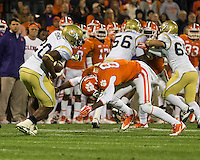 The eighth ranked Clemson Tigers defeat the Georgia Tech Yellow Jackets at Death Valley 55-31 in an ACC matchup.  Georgia Tech Yellow Jackets running back David Sims (20), Clemson Tigers defensive end Dane Rogers (85)