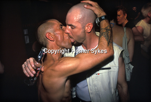 Manchester, Lancashire. 1999<br /> High on hope and a bit of rough trade gay sex, two stubble shaven dudes enjoy a lingering kiss at the Hollywood Showbar nightclub during the annual Pride Festival.