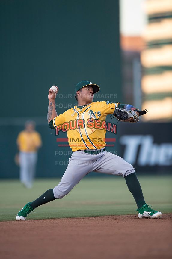 AZL Athletics shortstop Alexander Campos (8) makes a throw to first base during an Arizona League game against the AZL Angels at Tempe Diablo Stadium on June 26, 2018 in Tempe, Arizona. The AZL Athletics defeated the AZL Angels 7-1. (Zachary Lucy/Four Seam Images)