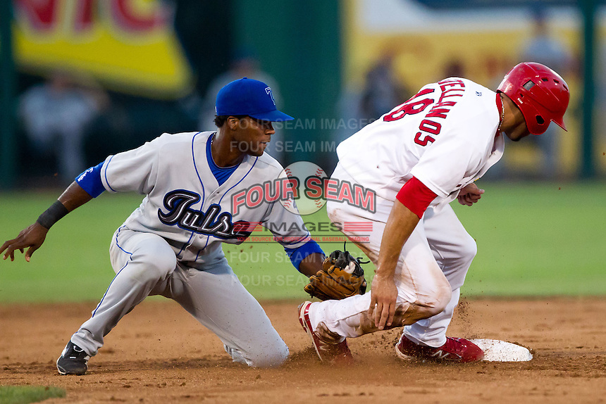 Alex Castellanos (18) of the Springfield Cardinals slides safely into second base during a game against the Tulsa Drillers at Hammons Field on July 19, 2011 in Springfield, Missouri. Tulsa defeated Springfield 17-11. (David Welker / Four Seam Images)