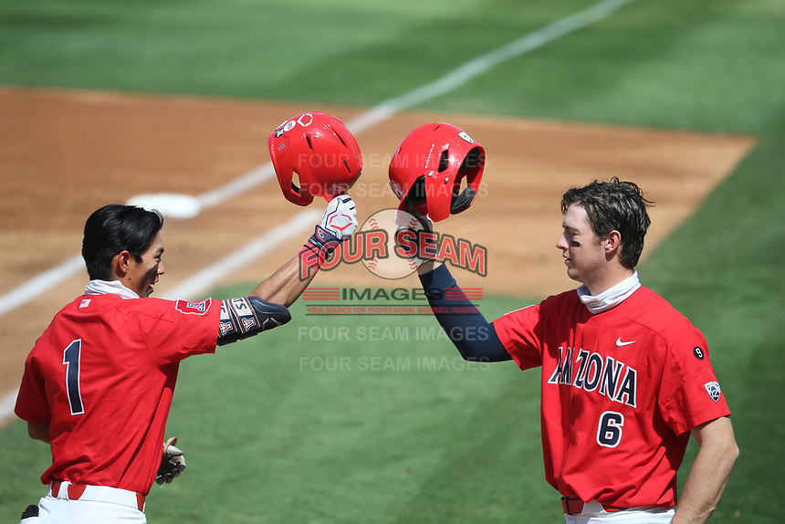 Kobe Kato (1) and Daniel Susac (6) of the Arizona Wildcats celebrate during a game against the UCLA Bruins at Jackie Robinson Stadium on March 20, 2021 in Los Angeles, California. Arizona defeated UCLA, 7-3. (Larry Goren/Four Seam Images)