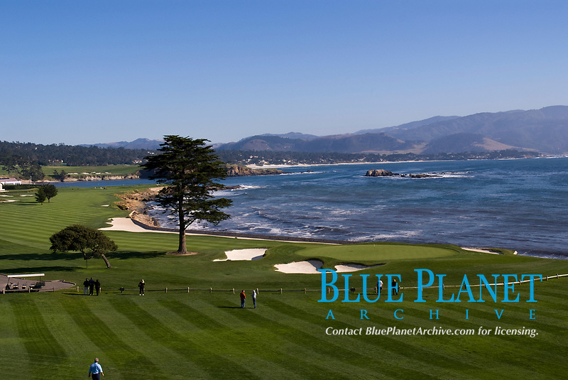View of the 18th green at Pebble Beach golf course with Stillwater Bay in the background. Pebble Beach, California