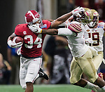 Alabama running back Damien Harris (34) stiff arms Florida State defensive back Derwin James(3) after a long gain in the first half of the Chick-fil-A Kickoff game at the new Mercedes-Benz Stadium in Atlanta, Georgia on September 2, 2017. Photo by Mark Wallheiser/UPI