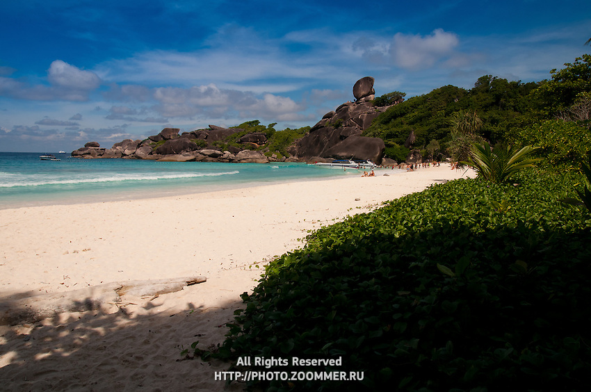 Similan Island panorama with sail rock and white sand beach