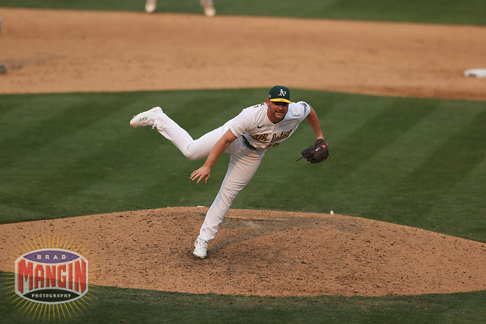OAKLAND, CA - OCTOBER 1:  Liam Hendriks #16 of the Oakland Athletics pitches against the Chicago Sox during Wild Card Round Game Three at the Oakland Coliseum on Thursday, October 1, 2020 in Oakland, California. (Photo by Brad Mangin)