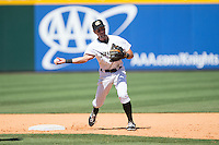Charlotte Knights shortstop Drew Garcia (2) makes a throw to first base against the Indianapolis Indians at BB&T BallPark on June 21, 2015 in Charlotte, North Carolina.  The Knights defeated the Indians 13-1.  (Brian Westerholt/Four Seam Images)
