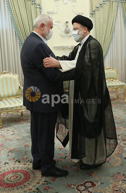 The head of the Hamas political bureau, Ismail Haniyeh, meets with Iran's newly President Ebrahim Raisi, in the capital Tehran, Iran on August 7, 2021. Photo by Head of the Hamas political bureau office