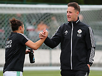 Head coach Jimmy Coenraets of OHL gives a high five to the Sara Yuceil (13) of OHL before a female soccer game between Oud Heverlee Leuven and AA Gent Ladies on the 9 th matchday of play off 1 in the 2020 - 2021 season of Belgian Womens Super League , saturday 22 nd of May 2021  in Heverlee , Belgium . PHOTO SPORTPIX.BE | SPP | SEVIL OKTEM