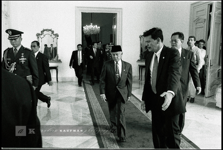 Summer '99-- Jakarta, Indonesia -- Moments after being sworn in a Indonesian President, the new President Habibee is swept away from the Presidential Palace.