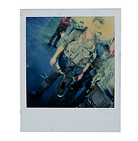 """BNPS.co.uk (01202) 558833. <br /> Pic: PropStore/BNPS<br /> <br /> Pictured: A continuity Polaroid photograph of Whip Hubley as """"Hollywood"""" is included in the sale. <br /> <br /> Costume props and behind-the-scenes photos from the classic Tom Cruise movie Top Gun are coming up for sale.<br /> <br /> The archive includes the white vest worn by Goose, the partner of Tom Cruise's character Pete 'Maverick' Mitchell, during the famous beach volleyball scene. <br /> <br /> There is also the flight suit worn by Maverick's Top Gun rival, Tom 'Iceman' Kazansky, played by Val Kilmer in the 1986 film."""