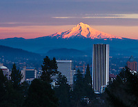 Gift card photo of snow capped Mt Hood is seen at sunset with alpine glow with city of Portland in the foreground.