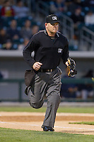 Home plate umpire Jonathan Bailey runs up the first base line during the International League game between the Gwinnett Braves and the Charlotte Knights at BB&T Ballpark on April 16, 2014 in Charlotte, North Carolina.  The Braves defeated the Knights 7-2.  (Brian Westerholt/Four Seam Images)