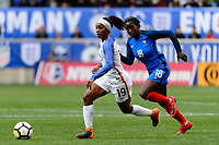 Harrison, NJ - Sunday March 04, 2018: Crystal Dunn, Viviane Asseyi during a 2018 SheBelieves Cup match match between the women's national teams of the United States (USA) and France (FRA) at Red Bull Arena.