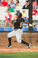 Henrry Rosario (52) of the Bristol Pirates follows through on his swing against the Johnson City Cardinals at Howard Johnson Field at Cardinal Park on July 6, 2015 in Johnson City, Tennessee.  The Pirates defeated the Cardinals 2-0 in game one of a double-header. (Brian Westerholt/Four Seam Images)