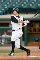 Louisville second baseman Jorge Cantu (3) follows through on his swing versus Indianapolis at Louisville Bats Field in Louisville, KY, Wednesday, August 8, 2007.