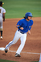 Dunedin Blue Jays designated hitter Bo Bichette (10) rounds third base to score a run on a Max Pentecost (not shown) double in the bottom of the third inning during a game against the Bradenton Marauders on July 17, 2017 at Florida Auto Exchange Stadium in Dunedin, Florida.  Bradenton defeated Dunedin 7-5.  (Mike Janes/Four Seam Images)