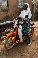 """BURKINA FASO, Kaya, Bokin, catholic order sister with scooter / Ordensschwester im Frauenhaus """"NAKOGLEBZANGA"""" in Tema-Bokin, Heim fuer zwangsverheiratete Frauen und Maedchen"""