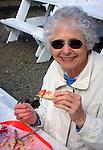 Donna Bennett eats Dungeness crab Lincoln Beach Oregon, eating crab, Dungeness crab, eating Dungeness crab, Oregon, Pacific Ocean, Plains, woods, mountains, rain, desert, rain, Rose City, Portland, Pacific Northwest, Fine Art Photography by Ron Bennett, Fine Art, Fine Art photography, Art Photography, Copyright RonBennettPhotography.com ©