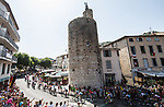 The peloton pass l'Horloge d'Anduze at the start of Stage 16 of the 2019 Tour de France running 177km from Nimes to Nimes, France. 23rd July 2019.<br /> Picture: ASO/Alex Broadway   Cyclefile<br /> All photos usage must carry mandatory copyright credit (© Cyclefile   ASO/Alex Broadway)