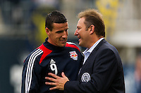 Philadelphia Union CEO Nick Sakiewicz talks with Sebastien Le Toux (9) of the New York Red Bulls before the match. The New York Red Bulls defeated the Philadelphia Union 3-0 during a Major League Soccer (MLS) match at PPL Park in Chester, PA, on October 27, 2012.