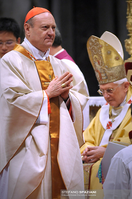 Pope Benedict XVI (L) gives his cardinal ring to Italian Gianfranco Ravasi (R) during the Eucharistic celebration with the new cardinals on November 21, 2010 at St Peter's basilica at The Vatican. 24 Roman Catholic prelates joined the day before the Vatican's College of Cardinals, the elite body that advises the pontiff and elects his successor upon his death.