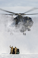 British Merlin helicopter practice in the Arctic, picking up loads in the terrain near Bardufoss, Norway. <br /> <br /> In 2019 the Arctic exercise Clockwork passed 50 years of training in Norway, and now has a permanent base within the Norwegian Air Force base at Bardufoss. <br /> <br /> 845 Naval Air Squadron is a squadron of the Royal Navy's Fleet Air Arm. Part of the Commando Helicopter Force, it is a specialist amphibious unit operating the Commando Merlin Mk3 helicopter and provides troop transport and load lifting support to 3 Commando Brigade Royal Marines.<br /> <br /> ©Fredrik Naumann/Felix Features