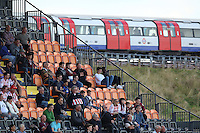 An underground train passes the Stevenage fans in the main stand during Barnet vs Stevenage, Sky Bet League 2 Football at the Hive Stadium, London, England on 19/09/2015