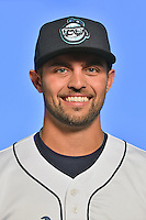 Asheville Tourists pitcher Dylan Craig (18) poses for a photo at Story Point Media on April 5, 2016 in Asheville, North Carolina. (Tony Farlow/Four Seam Images)