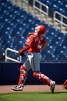 Washington Nationals catcher KJ Harrison (4) tracks a foul ball popup during an Instructional League game against the Miami Marlins on September 26, 2019 at FITTEAM Ballpark of The Palm Beaches in Palm Beach, Florida.  (Mike Janes/Four Seam Images)