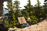 Artist drawing a mountain landscape scene