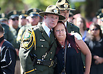 Honor Guard members comfort widow Rachel Howell outside a memorial service for her husband, Carson City Sheriff's Deputy Carl Howell at the Reno Events Center in Reno, Nev., on Thursday, Aug. 20, 2015. Howell was shot and killed early Saturday morning after responding to a domestic violence call. (Cathleen Allison/Las Vegas Review-Journal)