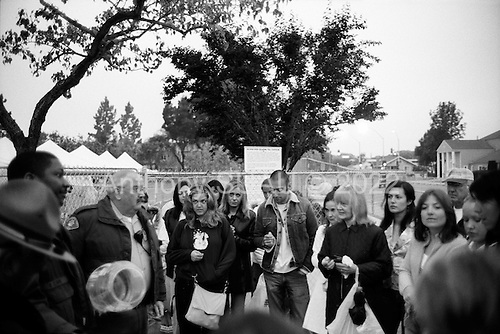 Santa Maria, California.USA.April 2005..Michael Jackson fans gather at 6 AM just outside the court house in hopes of winning one of the 46 lottery tickets to enter the court room to witness the child abuse trial of pop singer Michael Jackson...Mr. Jackson, 46, denies all 10 charges against him, including child abuse. He faces up to 20 years in jail if convicted on all charges.