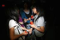 CHINA. Beijing. Young women talking. 2008