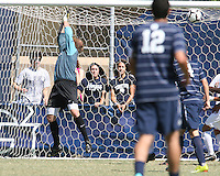 Steve Neumann #18 of Georgetown University scores during an NCAA match against Michigan State's Avery Steinlage #0 at North Kehoe Field, Georgetown University on September 5 2010 in Washington D.C. Georgetown won 4-0.