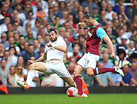 Andy Carroll of West Ham United and Jordi Amat of Swansea   during the Barclays Premier League match between West Ham United and Swansea City  played at Boleyn Ground , London on 7th May 2016