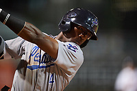 Pensacola Blue Wahoos second baseman Shed Long (4) follows through on a warm up swing while on deck during a game against the Birmingham Barons on May 8, 2018 at Regions Field in Birmingham, Alabama.  Birmingham defeated Pensacola 5-2.  (Mike Janes/Four Seam Images)