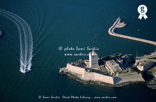 Boat passing along the fort of Fos-Sur-Mer, France (aerial view) (Licence this image exclusively with Getty: http://www.gettyimages.com/detail/82064692 )