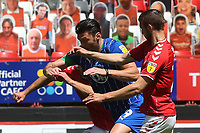 Kieffer Moore of Wigan tries to keep the Charlton players at arms length during Charlton Athletic vs Wigan Athletic, Sky Bet EFL Championship Football at The Valley on 18th July 2020