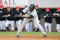 Kevin Jordan (21) of the Wake Forest Demon Deacons attempts to lay down a bunt against the Davidson Wildcats at Wilson Field on March 19, 2014 in Davidson, North Carolina.  The Wildcats defeated the Demon Deacons 7-6.  (Brian Westerholt/Four Seam Images)