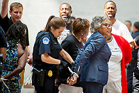 United States Representative Joyce Beatty (Democrat of Ohio), chair of the Congressional Black Caucus (CBC),  is arrested along with other voting rights activists during a protest for voting rights, in the atrium of the Hart Senate Office Building in Washington, DC, Thursday, July 15, 2021 <br /> CAP/MPI/RS<br /> ©RS/MPI/Capital Pictures