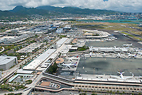 Aerial of Honolulu Int'l Airport with downtown Honolulu and the Koolau Mts in the distance