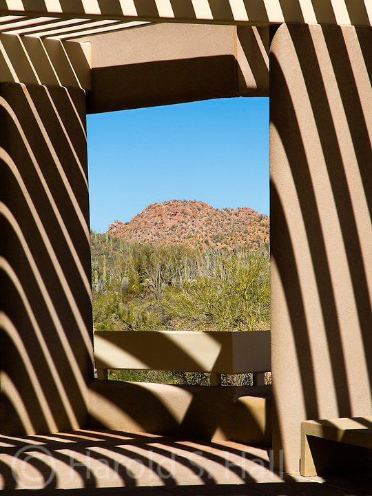 The Saguaro National Park in Arizona has a visitor center with interesting shadows from the sun shielding boards overhead.