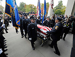 Hartford firefighters carry the casket of their colleague, firefighter Kevin Bell, to the church, during a funeral service, Monday, Oct. 13, 2014, at First Cathedral Church in Bloomfield. Bell was killed at a house fire in last week Hartford. (Jim Michaud / Journal Inquirer)