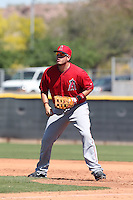 C.J. Cron #84 of the Los Angeles Angels during a Minor League Spring Training Game against the Oakland Athletics at the Los Angeles Angels Spring Training Complex on March 17, 2014 in Tempe, Arizona. (Larry Goren/Four Seam Images)