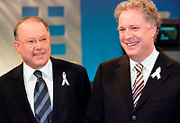 March 31 2003, Montreal, Quebec, Canada<br /> <br /> Bernard Landry, Quebec Premier and Leader of the Parti Quebecois(L) talk with <br /> Jean Charest, Leader of  Quebec Liberal Party<br /> (R) <br /> before  the Televised debate between leaders , March 31 2003 in Montreal, Canada.<br /> <br /> Quebec elections will be held April 14, 2003<br /> <br />  Photo by  Steeve Duguayl- Images Distribution. (©) Copyright 2003 by  Steeve Duguay