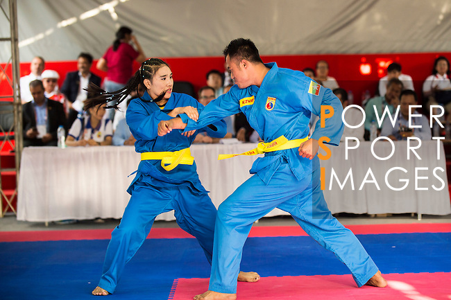 SU LAE Phyo and KHINE Zin Win of Myanmar in action during the Vovinam Mixed Events Self-defense for Women on Day Eight of the 5th Asian Beach Games 2016 at Bien Dong Park on 01 October 2016, in Danang, Vietnam. Photo by Marcio Machado / Power Sport Images