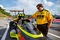 Jun 16, 2017; Bristol, TN, USA; NHRA pro mod driver Troy Coughlin Sr stands alongside the dragster of his son, top fuel driver Troy Coughlin Jr during qualifying for the Thunder Valley Nationals at Bristol Dragway. Mandatory Credit: Mark J. Rebilas-USA TODAY Sports
