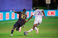 LAKE BUENA VISTA, FL - JULY 20: Jamiro Monteiro #10 of the Philadelphia Union and Ruan #2 of Orlando City SC battle for the ball during a game between Orlando City SC and Philadelphia Union at Wide World of Sports on July 20, 2020 in Lake Buena Vista, Florida.