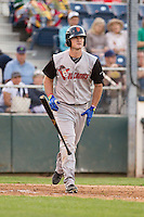 Sam Mende #20 of the Salem-Keizer Volcanoes flips his bat toward the dugout and trots down to first base after working a base on balls during a game against the Everett AquaSox at Everett Memorial Stadium in Everett, Washington on July 14, 2014.  Salem-Keizer defeated Everett 6-4.  (Ronnie Allen/Four Seam Images)