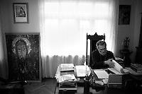"""Nagorny-Karabach, 10.05.2011, Shushi. Erzbischop Pargev Martirossian in seinem B¸ro in Schuschi. """"The Twentieth Spring"""" - ein Portrait der s¸dkaukasischen Stadt Schuschi, 20 Jahre nach der Eroberung der Stadt durch armenische K?mpfer 1992 im B¸gerkrieg um die Unabh?ngigkeit Nagorny-Karabachs (1991-1994). Archbishop Pargev Martirossian in his office. """"The Twentieth Spring"""" - A portrait of Shushi, a south caucasian town 20 years after its """"Liberation"""" by armenian fighters during the civil war for independence of Nagorny-Karabakh (1991-1994). .L'archevêque Pargev Martirossian dans son bureau.""""Le Vingtieme Anniversaire"""" - Un portrait de Chouchi, une ville du Caucase du Sud 20 ans après sa «libération» par les combattants arméniens pendant la guerre civile pour l'indépendance du Haut-Karabakh (1991-1994).© Timo Vogt/Est&Ost, NO MODEL RELEASE !"""